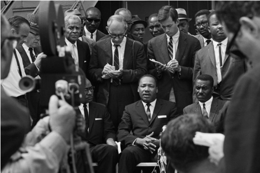 The Rev. Dr. Martin Luther King Jr. with a gaggle of reporters