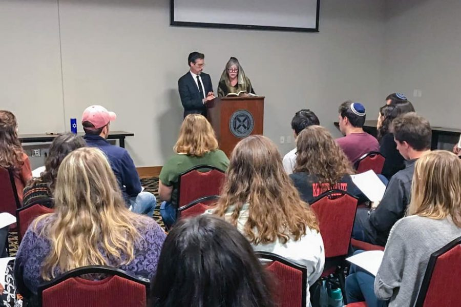 Students, faculty and staff gather resolve following the recent synagogue shooting.
